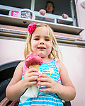 Prairie Meadows was a buss with exotic and worldly foods during its Food Truck Festival held June 17. Elaina Josephson, 3, of Huxley enjoyed a big scoop of Triple Berry Sorbet from the Outside Scoop.