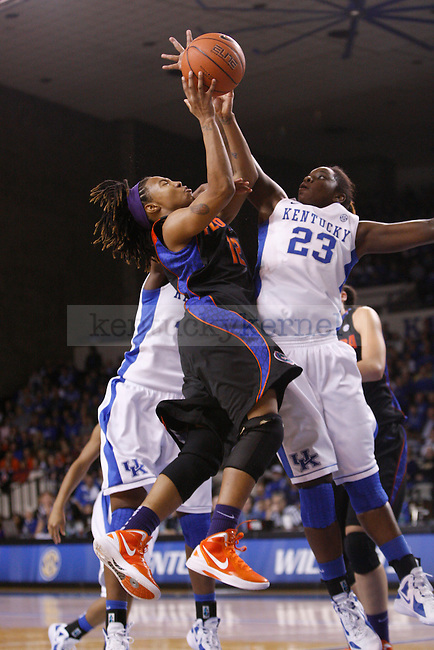 UK forward Samarie Walker blocks Florida's Deana Allen during the first half of the UK Women's basketball game against Florida on 1/22/12 at Memorial Coliseum in Lexington, Ky. Photo by Quianna Lige | Staff