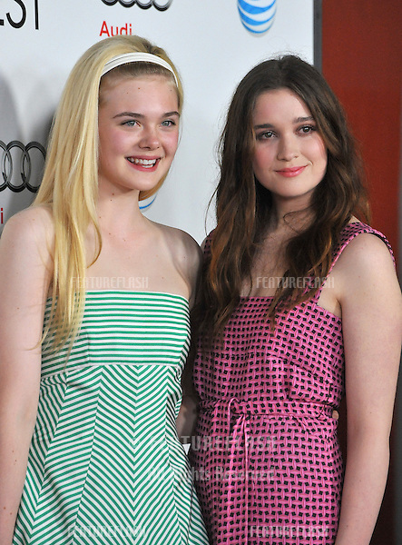 "Elle Fanning & Alice Englert (right) at the AFI Fest 2012 premiere of their movie ""Ginger and Rosa"" at Grauman's Chinese Theatre, Hollywood..November 7, 2012  Los Angeles, CA.Picture: Paul Smith / Featureflash"