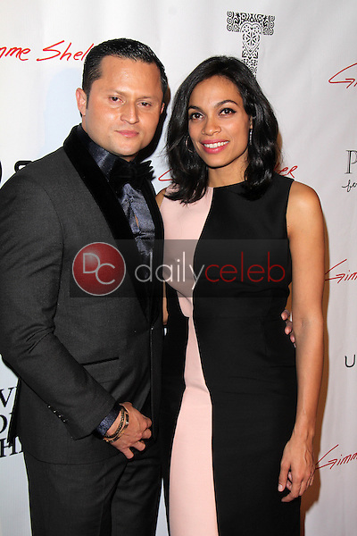 Oskar Rivera, Rosario Dawson<br /> at the &quot;Gimme Shelter&quot; Los Angeles Screening, Egyptian Theater, Hollywood, CA 01-14-14<br /> David Edwards/DailyCeleb.Com 818-249-4998