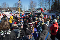 Volunteer dog handlers gather for a meeting prior to the Restart of the 2016 Iditarod in Willow, Alaska.  March 06, 2016.