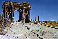 North Africa: Timgad--Timgad Arch (Trajan's Arch) as it appeared when one approached the city. Ruins are located in modern-day  Algeria.