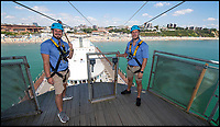 BNPS.co.uk (01202 558833)<br /> Pic: PhilYeomans/BNPS<br /> <br /> Bournemouth zip wire mangers l-r Chris Stradwick and Joe Potter. 'Perfect weather this year'<br /> <br /> The summer heatwave is leading to a 'bumper year' for tourism at Britain's premier seaside resort.<br /> <br /> Over 100,000 people are visiting Bournemouth, Dorset, every weekend and hotels are full to capacity, with restaurants packed and huge queues at ice cream stalls.<br /> <br /> Seafront kiosks are selling out of parasols and sun cream, while one bike hire company has reported a 50 per cent increase in business.