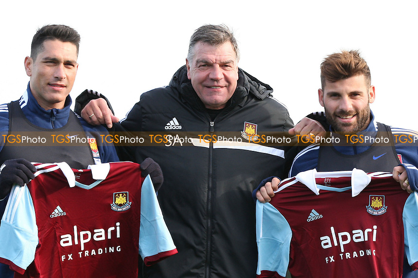 West Ham manager Sam Allardyce with his 2 new Italian signings Marco Borriello (left) and Antonio Nocerino (right) - West Ham United Training Session at Chadwell Heath, London - 27/01/14 - MANDATORY CREDIT: Rob Newell/TGSPHOTO - Self billing applies where appropriate - 0845 094 6026 - contact@tgsphoto.co.uk - NO UNPAID USE