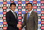 (L-R)  Takashi Sekizuka,  Norio Sasaki (JPN), JULY 2, 2012 - Football / Soccer : Japan Men's head coach Takashi Sekizuka shakes hands with Women's head coach Norio Sasaki during the press conference of 2012 London Olympic Games squad announcement at The Capitol Hotel Tokyu, Tokyo, Japan. (Photo by Atsushi Tomura/AFLO SPORT)