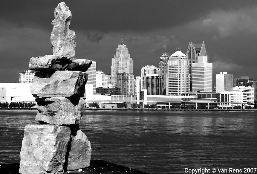 Canadian humor has the juxtaposition of the Windsor river park rock stack with the Detroit skyline.