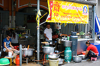 A street cafe in Bangkok gets ready for the evening dinner trade.