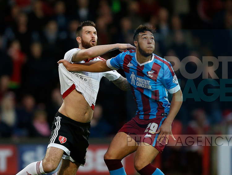 David Edgar of Sheffield Utd tussles with Kyle Wootton of Scunthorpe Utd - English League One - Scunthorpe Utd vs Sheffield Utd - Glandford Park Stadium - Scunthorpe - England - 19th December 2015 - Pic Simon Bellis/Sportimage