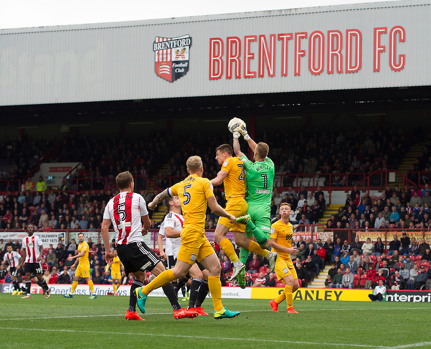 Brentford's Daniel Bentley collects the ball in front of Preston North End's Jordan Hugill<br /> <br /> Photographer Ashley Western/CameraSport<br /> <br /> The EFL Sky Bet Championship - Brentford v Preston North End - Saturday 17 September 2016 - Griffin Park - London<br /> <br /> World Copyright &copy; 2016 CameraSport. All rights reserved. 43 Linden Ave. Countesthorpe. Leicester. England. LE8 5PG - Tel: +44 (0) 116 277 4147 - admin@camerasport.com - www.camerasport.com