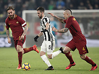 Calcio, Serie A: Juventus - AS Roma, Torino, Allianz Stadium, 23 dicembre, 2017. <br /> Juventus' Miralem Pjanic (c) in action with Roma's captain Daniele De Rossi (l) and Radja Nainggolan (r) during the Italian Serie A football match between Juventus and Roma at Torino's Allianz stadium, December 23, 2017.<br /> UPDATE IMAGES PRESS/Isabella Bonotto