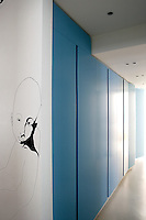 "The bedrooms, which all open on to an inner courtyard, run along this corridor behind panels painted a ""glacier blue"""