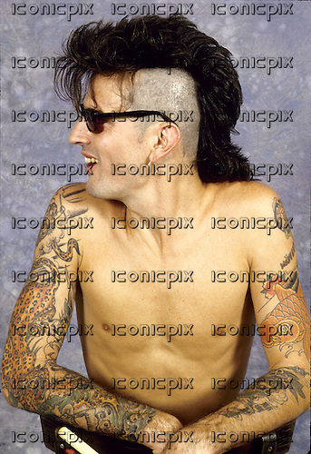 Motley Crue - drummer Tommy Lee -  photographed exclusively backstage at the Rock Werchter Festival, Werchter, Belgium - 30 Aug 1991.  Photo by: George Chin/IconicPix