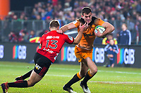 Jaguares' Emiliano Boffelli hands off Crusaders' Braydon Ennor during the 2019 Super Rugby final between the Crusaders and Jaguares at Orangetheory Stadium in Christchurch, New Zealand on Saturday, 6 July 2019. Photo: Dave Lintott / lintottphoto.co.nz