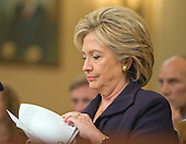 Former United States Secretary of State Hillary Rodham Clinton, a candidate for the 2016 Democratic Party nomination for President of the United States, looks over her notes prior to giving testimony before the US House Select Committee on Benghazi on Capitol Hill in Washington, DC on Thursday, October 22, 2015.<br /> Credit: Ron Sachs / CNP