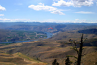 A paraglider pilot flies over the Columbia River south of Chelan Washington which is famous for its flying conditions