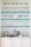 Our Clouds stone mosaic is the highlight of this niche dry bar in a contemporary East Hamptons home.<br />