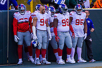 New York Giants guard Bobby Hart (68), linebacker Mark Herzlich (94), defensive tackle Damon Harrison (98) and defensive tackle Johnathan Hankins (95) prior to a game against the Green Bay Packers on January 8th, 2017 at Lambeau Field in Green Bay, Wisconsin.  Green Bay defeated New York 38-13. (Brad Krause/Krause Sports Photography)