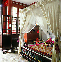 The bed was designed by Jehanne's husband Harrison Liu with tassels and cushions by Jehanne