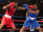 Abraham Nova, left, and Gary Russell compete in the U.S. Olympic Boxing Trials in Reno, Nev., on Wednesday, Dec. 9, 2015. (AP Photo/Cathleen Allison)
