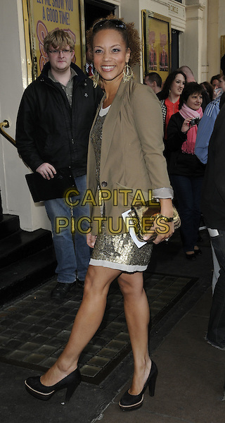 ANGELA GRIFFIN.Attending the 'Sweet Charity' Press Night at the Theatre Royal, Haymarket, London, England UK, May 4th 2010. .full length black gold dress jacket beige brown mac shoes clutch bag side.CAP/CAN.©Can Nguyen/Capital Pictures.