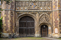 UK, England, Cambridge.  The Great Gate, Entrance to Trinity College, founded 1546 by Henry VIII.  Coats of arms of King Edward III and his six sons.  The blank one is that of William Hatfield, who died in infancy.