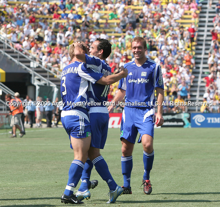 30 July 2005: Taylor Twellman (3), Landon Donovan (10) and Jimmy Conrad (r) celebrate after Twellman's 23rd minute goal had given the MLS All-Stars a 1-0 lead. Major League Soccer's All-Stars defeated Fulham FC of the English Premier League 4-1 at Columbus Crew Stadium in Columbus, Ohio in the 2005 Sierra Mist MLS All-Star Game..