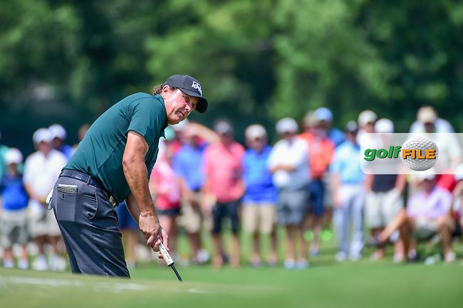 Phil Mickelson (USA) watches his putt on 4 during Thursday's round 1 of the PGA Championship at the Quail Hollow Club in Charlotte, North Carolina. 8/10/2017.<br /> Picture: Golffile | Ken Murray<br /> <br /> <br /> All photo usage must carry mandatory copyright credit (&copy; Golffile | Ken Murray)