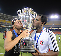 DC United midfielder Fred (7) letf and forward Luciano Emilio (11) right kiss the US Open Cup Trophy, DC United defeated The Charleston Battery 2-1 to win the US Open Cup, Wednesday September 3, 2008 at RFK Stadium.
