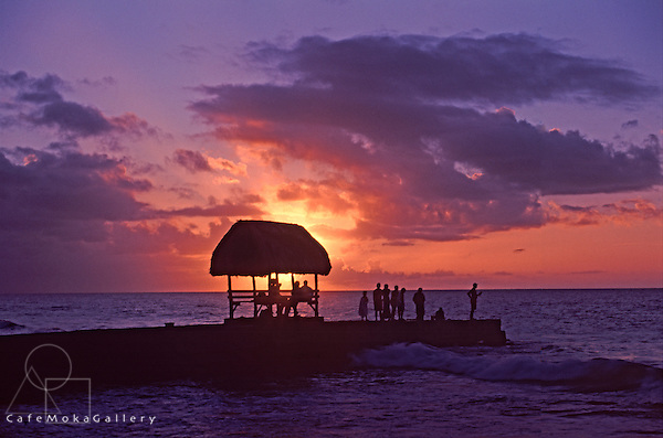 Group of people watching the spectacular sunset from the jetty, Tobago