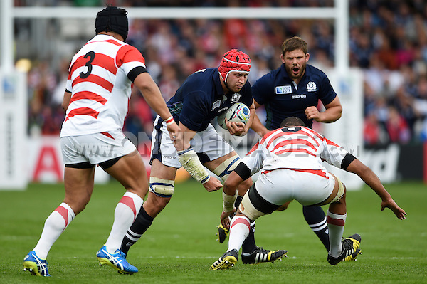 Grant Gilchrist of Scotland goes on the charge. Rugby World Cup Pool B match between Scotland and Japan on September 23, 2015 at Kingsholm Stadium in Gloucester, England. Photo by: Patrick Khachfe / Onside Images