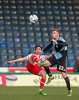 Jason McCarthy of Wycombe Wanderers & Offrande Zanzala of Stevenage in action during the Sky Bet League 2 match between Wycombe Wanderers and Stevenage at Adams Park, High Wycombe, England on 12 March 2016. Photo by Andy Rowland/PRiME Media Images.