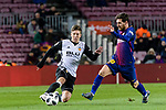 Lionel Messi of FC Barcelona (R) fights for the ball with Luciano Vietto of Valencia CF (L) during the Copa Del Rey 2017-18 match between FC Barcelona and Valencia CF at Camp Nou Stadium on 01 February 2018 in Barcelona, Spain. Photo by Vicens Gimenez / Power Sport Images