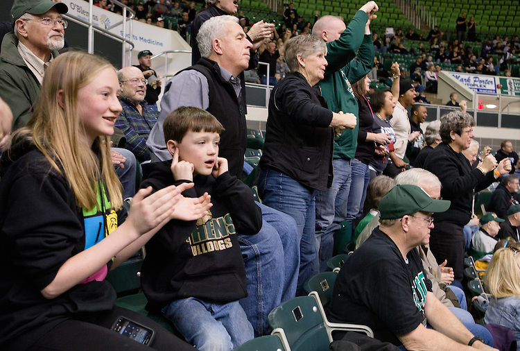 Erik Dabelko, 9, plugs his ears as fans cheer for the Ohio University men's basketball team during a game against Toledo on Feb. 1, 2014, in Athens. Photo by Lauren Pond