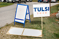 Campaign signs stand in the grass for a campaign event for Democratic presidential candidate and Hawaii representative (D-HI 2nd) Tulsi Gabbard at Weare Public Library in Weare, New Hampshire, on Thu., September 5, 2019.