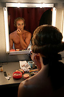 Royal Ballet dancer Gary Avis applies make up backstage for his role as Monsieur G.M. in Manon