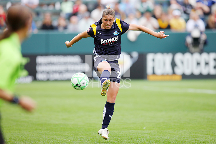 Kendall Fletcher #2 of the Los Angeles Sol stops a loose ball against the Washington Freedom during their inaugural match at Home Depot Center on March 29, 2009 in Carson, California.