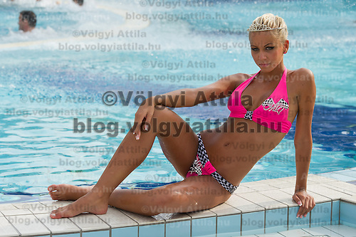 Szilvia Kalman poses after winning the Miss Bikini Hungary beauty contest held in Budapest, Hungary on August 06, 2011. ATTILA VOLGYI