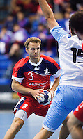 05 APR 2012 - LONDON, GBR - Great Britain's Ciaran Williams (GBR) (#3, in red and blue) (GBR) looks for a way through the Argentinian defence during the men's 2012 London Cup match at the National Sports Centre in Crystal Palace, Great Britain .(PHOTO (C) 2012 NIGEL FARROW)