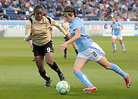 # 8 Megan Rapinoe of the Red Stars pushes the ball up against # 9 Kandace Wilson of FC Gold Pride.   FC Gold Pride beat the Red Stars 1-0.
