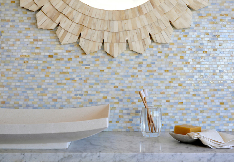 Smalti, a hand cut glass mosaic shown in Agate, Pearl, Quartz, Opal, is part of the Erin Adams Collection for New Ravenna.