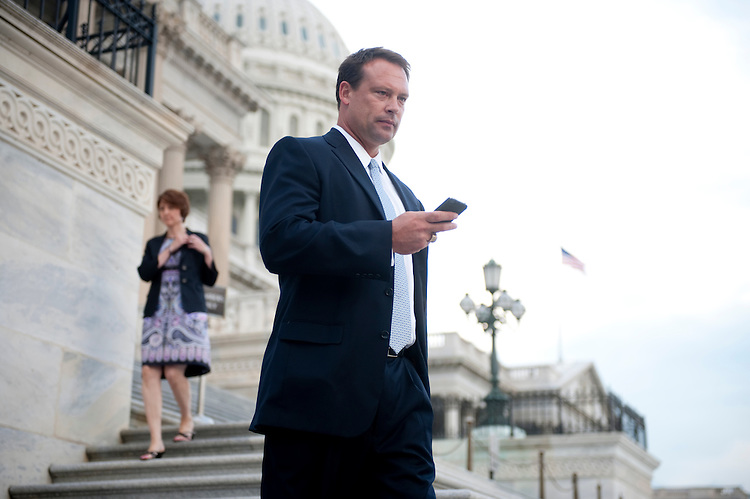 UNITED STATES - AUGUST 1: Rep. Heath Shuler, D-N.C., walks down the House steps at the Capitol following the vote on the debt ceiling bill in the House of Representatives on Monday, Aug. 1, 2011. (Photo By Bill Clark/Roll Call)