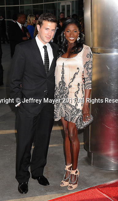 "HOLLYWOOD, CA - JUNE 21: Jacob Fishel and Rutina Wesley  arrive at HBO's ""True Blood"" Season 4 Premiere at The Dome at Arclight Hollywood on June 21, 2011 in Hollywood, California."