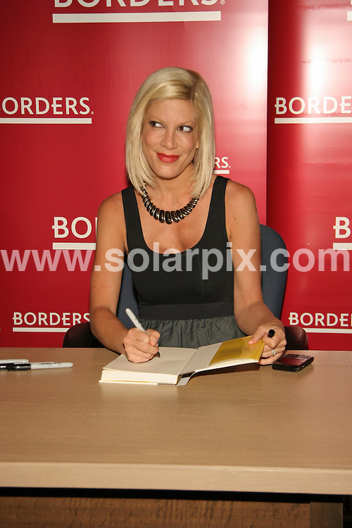 **ALL ROUND PICTURES FROM SOLARPIX.COM**.**SYNDICATION RIGHTS FOR UK, AUSTRALIA, DENMARK, PORTUGAL, S. AFRICA, SPAIN & DUBAI (U.A.E) & ASIA (EXCLUDING JAPAN) ONLY**.Tori Spelling Uncharted TerriTORI Book Signing at Borders in Las Vegas, NV, USA, 13 August 2010.This pic: Tori Spelling.JOB REF: 11917    PHZ prn   DATE: 13_08_2010.**MUST CREDIT SOLARPIX.COM OR DOUBLE FEE WILL BE CHARGED**.**MUST NOTIFY SOLARPIX OF ONLINE USAGE**.**CALL US ON: +34 952 811 768 or LOW RATE FROM UK 0844 617 7637**