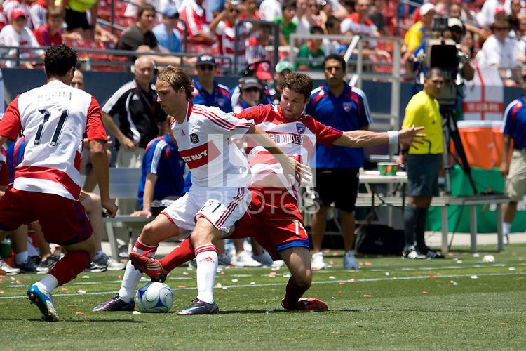 Chicago Fire midfielder Justin Mapp (21)  shields the ball from FC Dallas defender Drew Moor (14). Chicago Fire vs FC Dallas at Pizza Hut Park Frisco, Texas June-15-2008.  FC Dallas 1, Chicago 0.