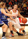 SIOUX FALLS, SD - JANUARY 31:  Denae Veldkamp #12 from Washington drives against Claire Howes #15 from O'Gorman in the first half of their game Thursday night at Washington. (Photo by Dave Eggen/Inertia)