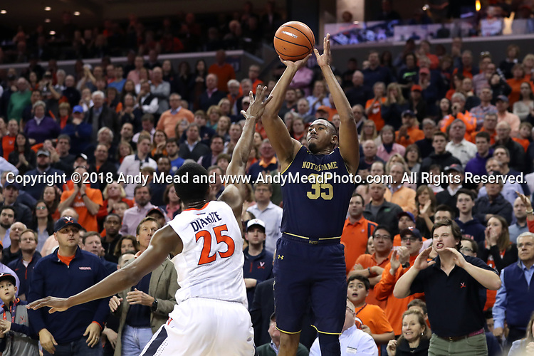 CHARLOTTESVILLE, VA - MARCH 03: Notre Dame's Bonzie Colson (35) shoots over Virginia's Mamadi Diakite (GUI) (25). The University of Virginia Cavaliers hosted the University of Notre Dame Fighting Irish on March 3, 2018 at John Paul Jones Arena in Charlottesville, VA in a Division I men's college basketball game. Virginia won the game 62-57.