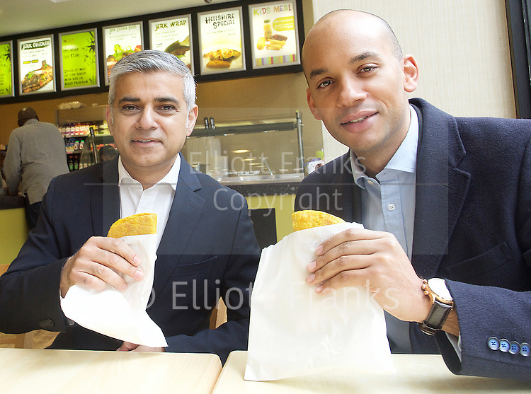 Sadiq Khan <br /> Labour mayor of London candidate and Chuka  Umunna MP for Brixton &amp; Streatham walk around Brixton canvassing locals to support Labour in the forthcoming 5th May election.<br /> <br /> Sadiq Khan <br /> Chaka Umunna <br /> in Healthy Eaters Jamaican Cuisine in Electric Lane Brixton <br /> <br /> Photograph by Elliott Franks <br /> Image licensed to Elliott Franks Photography Services