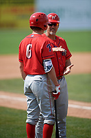 Williamsport Crosscutters manager Pat Borders (10) talks with Nick Maton (6) during the first game of a doubleheader against the Batavia Muckdogs on August 20, 2017 at Dwyer Stadium in Batavia, New York.  Batavia defeated Williamsport 6-5.  (Mike Janes/Four Seam Images)