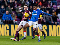 26th January 2020, Tynecastle Park, Edinburgh, Scotland; Scottish Premier League football, Hearts of Midlothian versus Rangers; Andrew Irving of Hearts and Joe Aribo of Rangers tussle for the ball