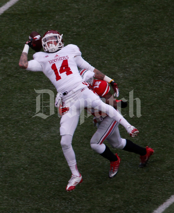 OhioState BuckeyeOhio State Buckeyes cornerback Doran Grant (12)breaks up pass in first quarter against Indiana Hoosier wide receiver Nick Stoner (14) at Ohio State Stadium in Columbus  Nov. 23, 2013.